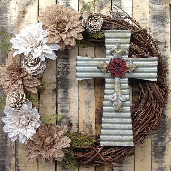 This handmade/hand assembled wreath with a metal cross is large, approximately 30 in diameter, perfect to adorn a front door welcoming friends and family for any season and any celebration. Sturdy dried grapevine base, quality starched burlap flowers, Wooden Flowers, mesh leaves, and decorative elements make this wreath a semi-rustic, yet refined addition to any décor. Perfect for the entire year. Shipped and packed with care in a durable box appropriate for storage.