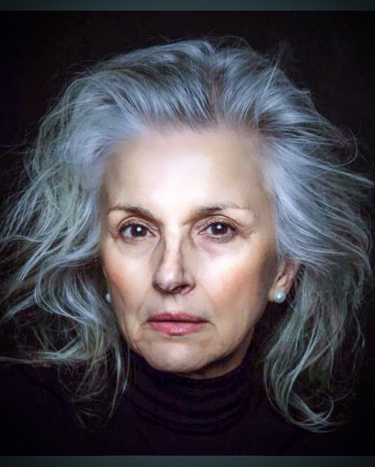Long silver grey hair, swept back