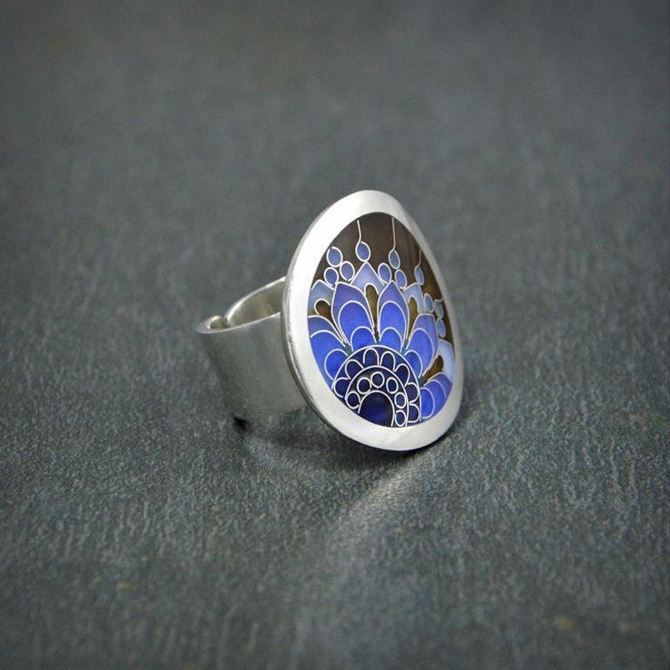 """Silver ring decorated with blue shades ornament made of Georgian enamel """"Minankari"""" known as Cloisonne."""