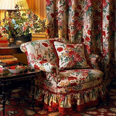 Gorgeous sitting room with red and green chintz with red-grounded rug. By Colfax and Fowler