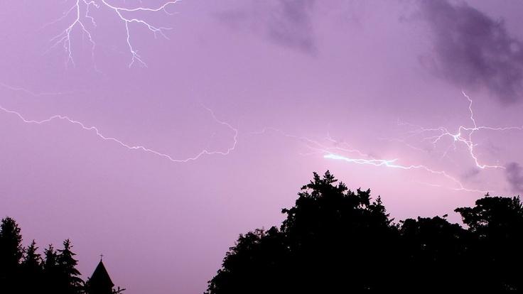 White lightning cutting across a purple sky - Slovakia.