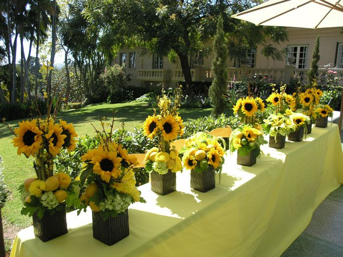 sunflower and daisies wedding | Table of Citrus Theme Sunflower arrangements displayed