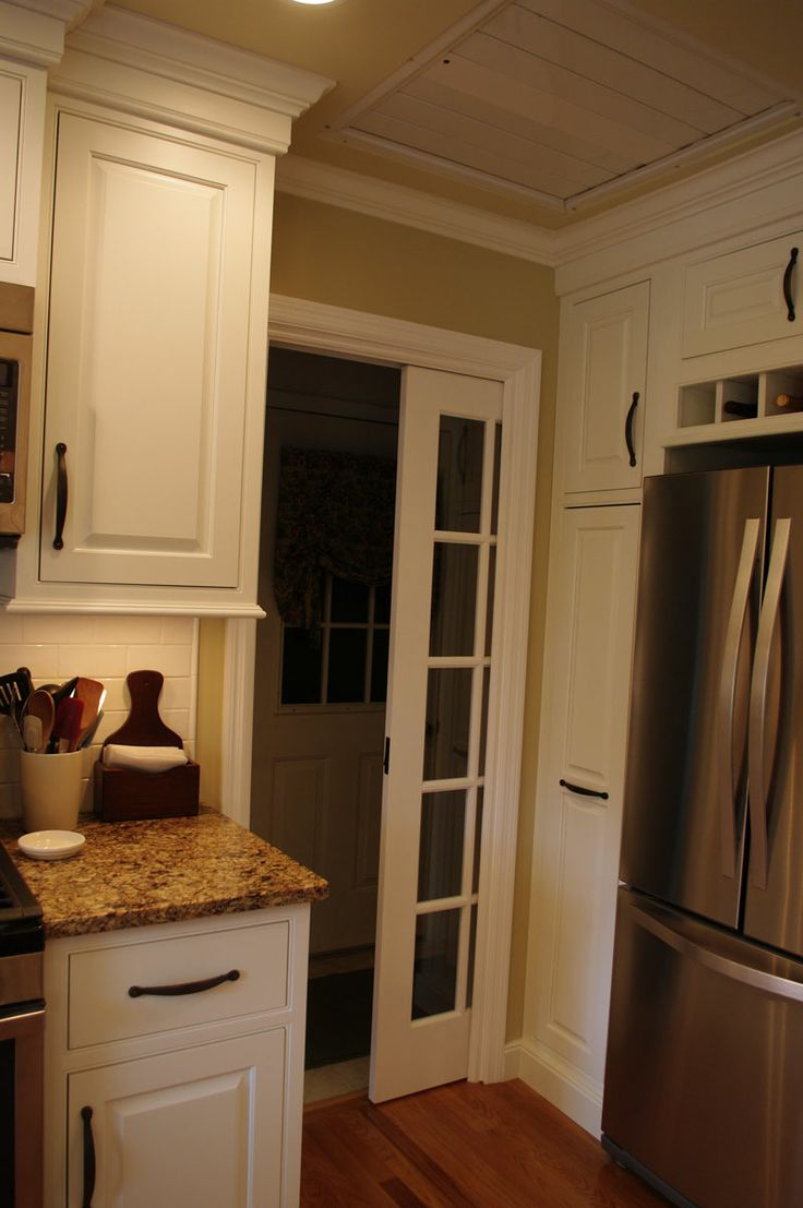 pocket door to laundry room recently completed renovation by landmark cabinetry shiloh cabinetry - Beaded Inset Restaurant Interior