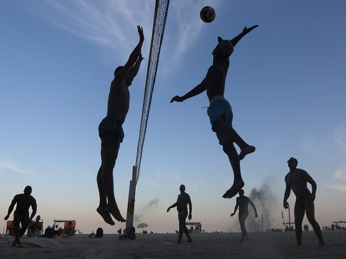 Brazilians play beach volleyball on Copacabana beach,