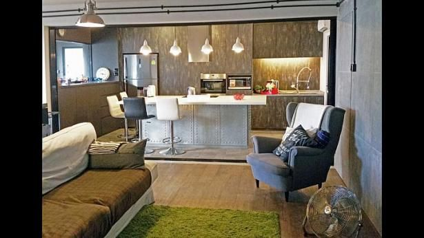 This five-room resale HDB flat in Pasir Ris features an open kitchen, designed by interior design firm Aiden T., that comes complete with a kitchen island and built-in appliances. -- PHOTO: ARJAN NIJEN TWILHAAR