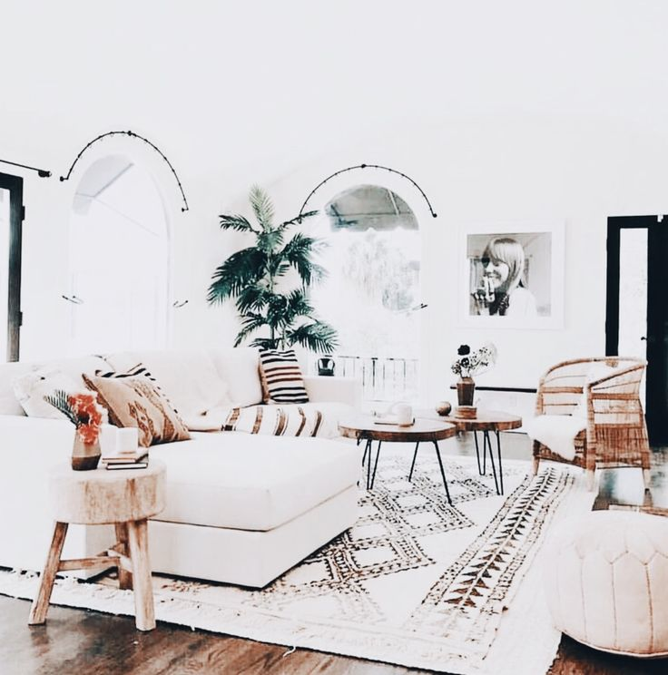 All white and clean contemporary living area with light wood accents to warm it up