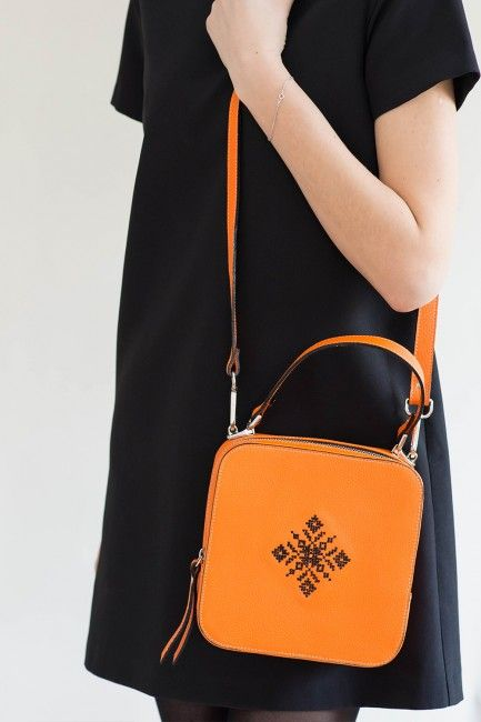 Magpie Orange Embroidered Leather bag with a signature folk design