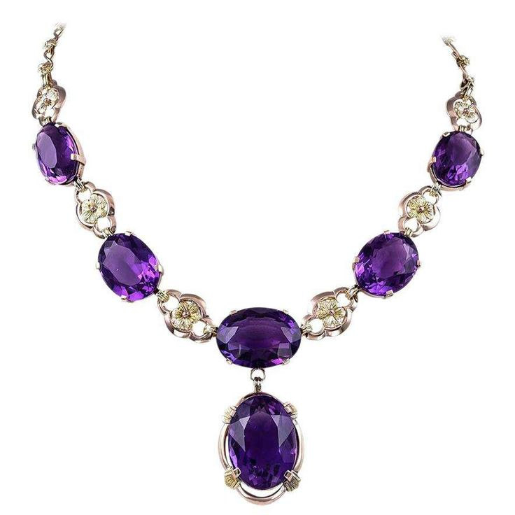 """Art Nouveau Amethyst and Gold Drop Necklace. Luscious and glamorous one of a kind necklace. Six large plump faceted Amethysts on a beautiful yellow and white Gold floral link chain, suspending a larger single Amethyst. 16"""" long. Approximately 75 carats of brilliantly saturated Amethysts. 14K Gold. A singular dramatic piece of jewelry that sets a mood and tells a story."""