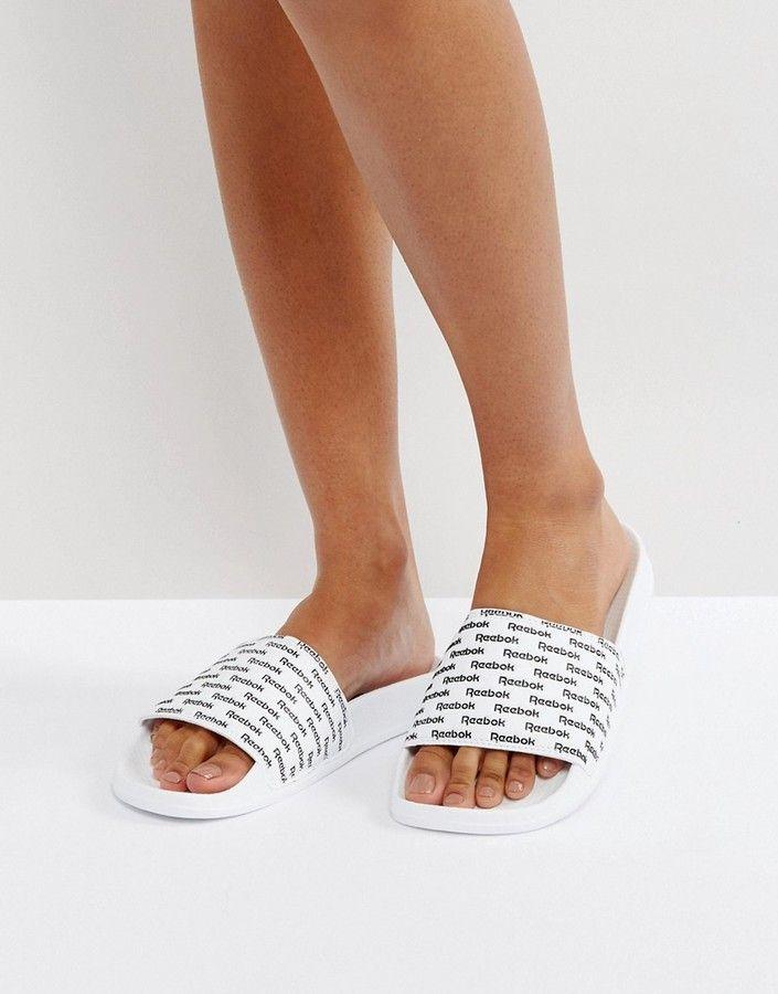 Reebok – Klassische Slider in Schwarz und Weiß mit Print Damen Mode Trends und Fashion Ideen
