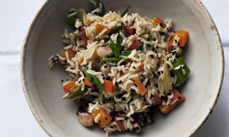 Beautiful to behold: Nigel Slater's brown rice, carrot and cashew vegetarian pilau recipe. Photograph: Jonathan Lovekin for the Observer