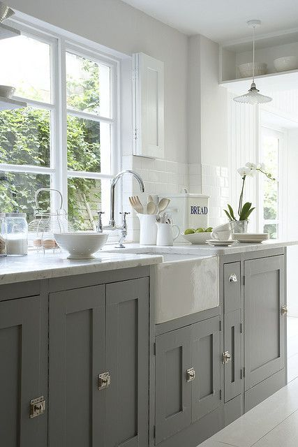 Clever choice of colour scheme gives this Farmhouse kitchen a fresh modern look. www.nestkitchens.co.uk
