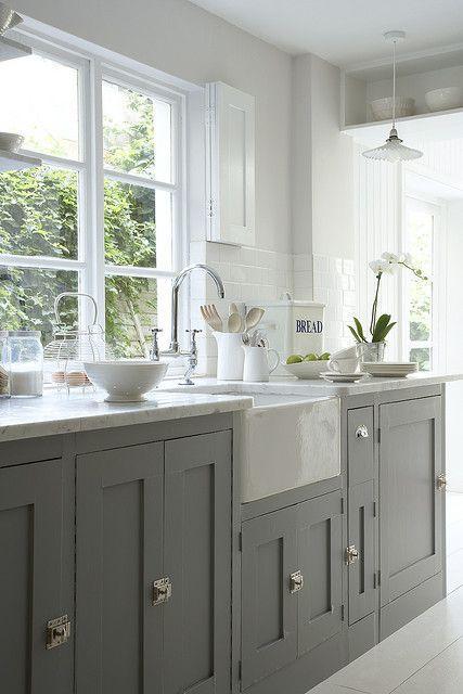 Grey/white kitchen units and white floor, lovely windows x