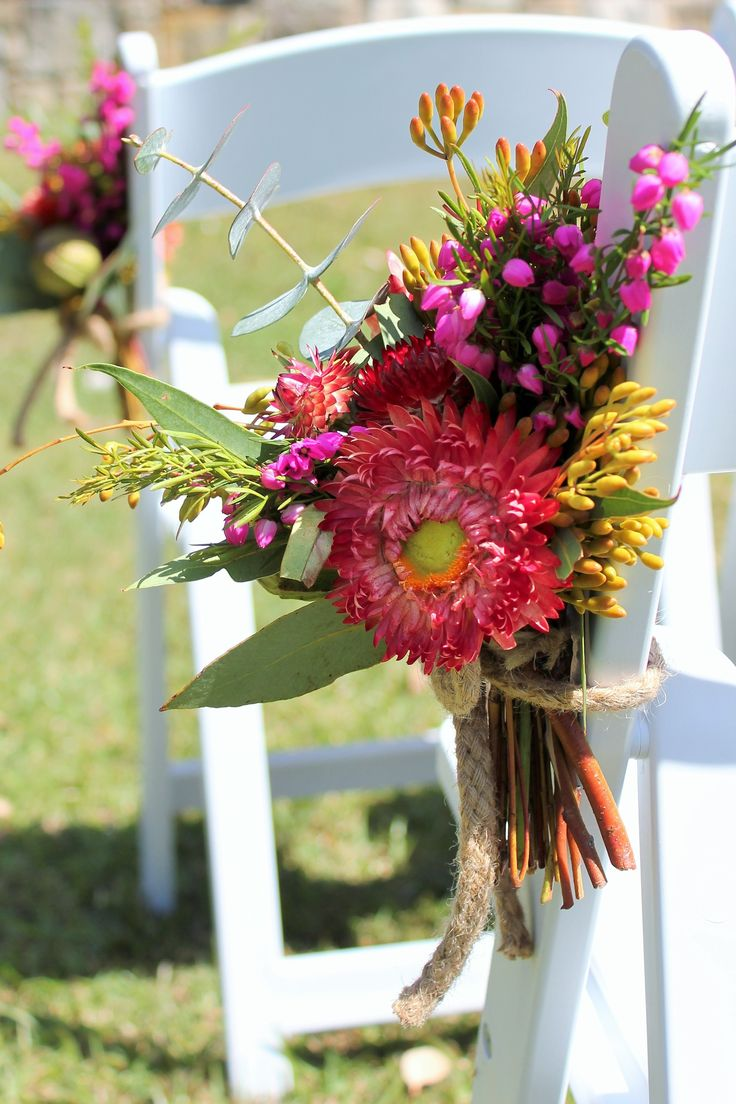 White House Flowers   wedding chair back of red paper daisies, pink boronia, eucalyptus gum buds
