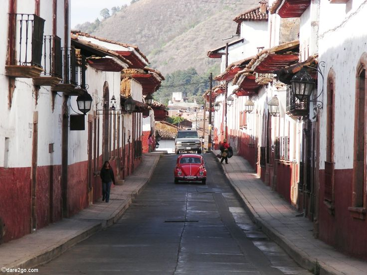 Red #Beetle coming down a street in #Patzcuaro, Mexico.