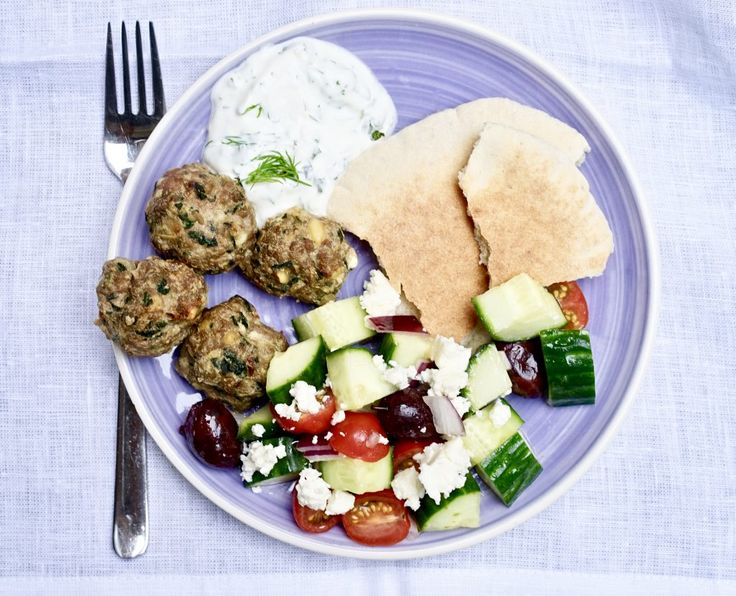 These quick and easy lamb meatballs have spinach, pine nuts, and feta cooked right into them! Serve them with a simple horiatiki salad and dinner is done.