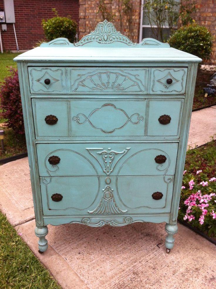 Very detailed antique dresser painted aqua.