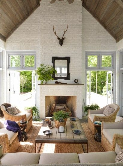 Beautiful ceilings and glass doors flanking fireplace