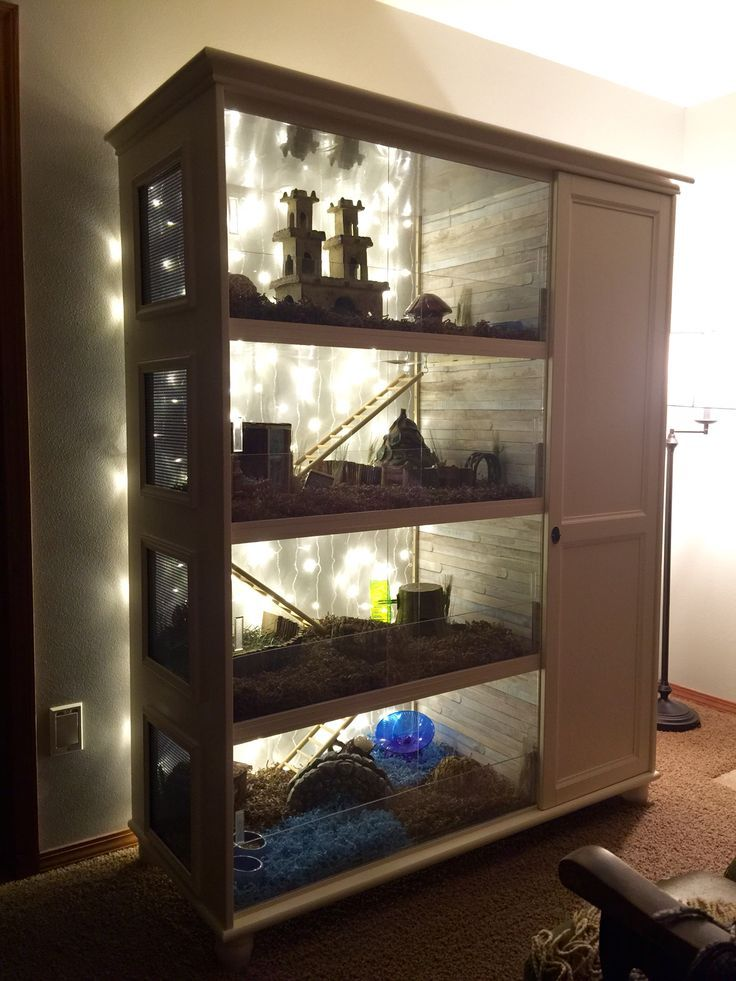 DIY wooden small pet cage converted from a wardrobe. I love how the LED lights brighten up the cage. So beautiful.