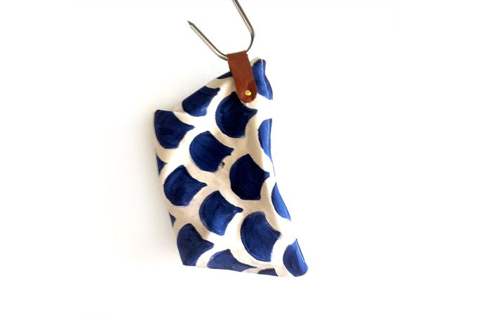 This pouch is the perfect keep it all pouch. We made it from canvas material and used metal rivets and leather to finish it off. We used our rainbow patter.  For sale on http://hellopretty.co.za