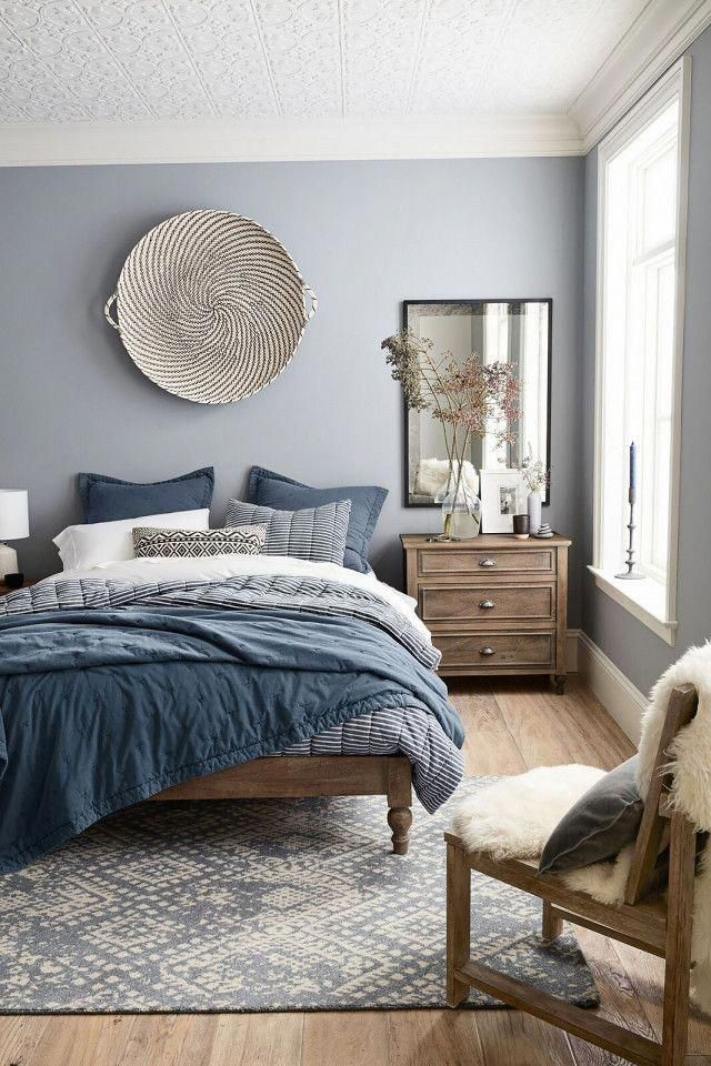 Modern Bedroom Design Featuring A Blue Gray White And Wood Tone