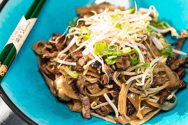 Beef and flat noodle stir fry