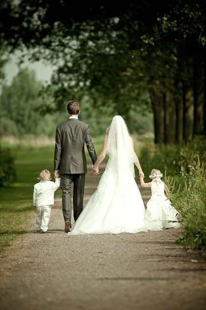 Bride, Groom, ring bearer and flower girl! We have more than one flower girl and ring bearer...would be cute to have everyone holding hands!