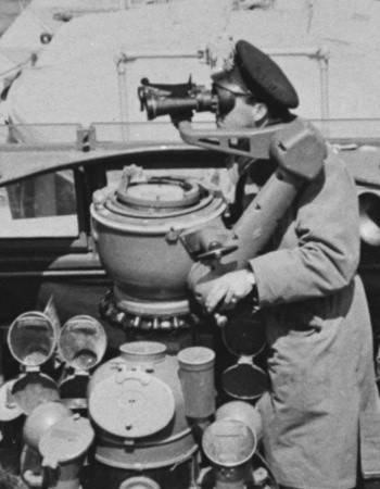 A member of the Royal Canadian Navy is on the lookout for enemy vessels during this World War II-era photograph. By the end of the Second World War, Canada had the third-largest navy in the world.