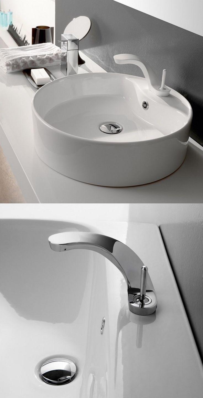 grifo precioso con diseño único con lavabo de porcelana blanca