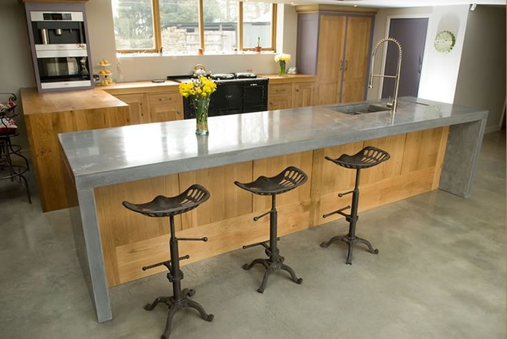 wooden kitchen with concrete worktop from lovewoodfurniture.co.uk