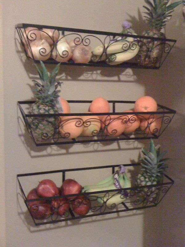 Check out my new kitchen baskets! Purchased outdoor garden baskets, took out the linings and voila! Only $10 each from Liquidation World (Big Lots in the U.S.) versus the expensive kitchen versions :)