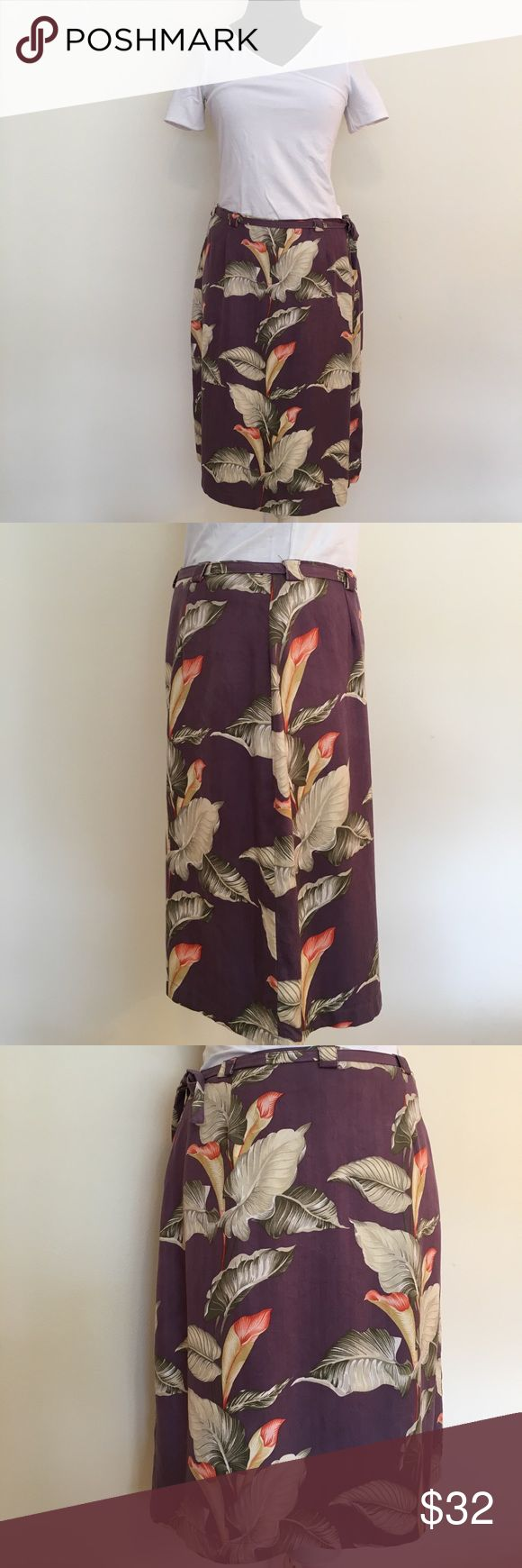 """Tommy Bahama washed silk skirt Tommy Bahama washed silk skirt in tropical print with purple background. Measurements: length 21"""", waist 30"""", hip 42"""". Hidden side zip. fabric belt and side slit. Tommy Bahama Skirts Midi"""