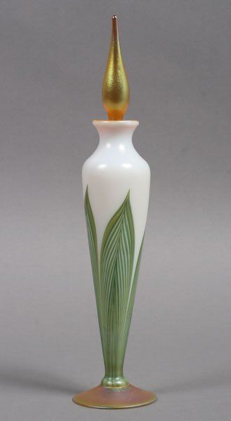 "Pretty art glass scent bottle with classic feather design signed 'L.C. Tiffany Favrile.' Ht: 10.5"" Sold for $500 in 2012"