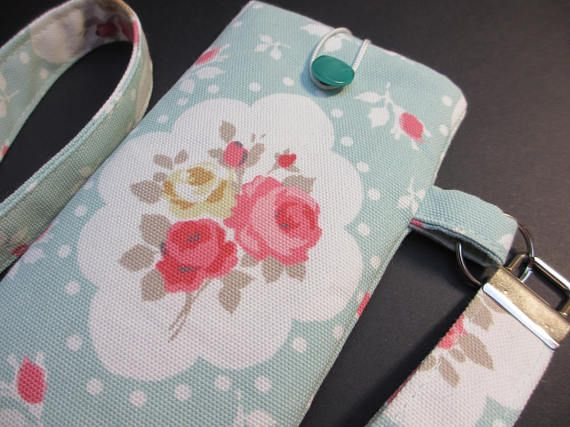 A pretty case in duck egg blue with cameo of flowers. Lined in a contrasting lining and secured with a button. Supplied with a detachable neck lanyard chain of 39 - 1m. Great to wear around the neck when you dont need a bag. Dog walking or the gym. Can be used for a phone or glasses. Case size 6.5 x 3.5 - 165mm x 88.9mm.  To fit a phone approx 5.75 x 3 146 mm x 76.2 mm.   An example of phones the case will fit. Please contact me if you are not sure of sizing iPhone 4/ 5C/6/6S&#...