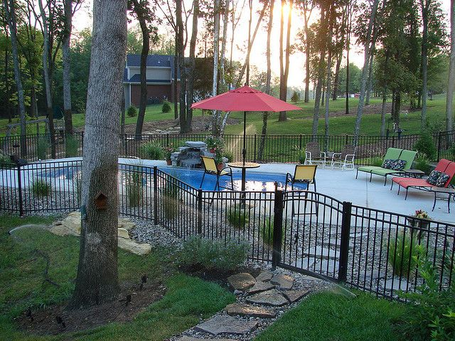 Inground Pool Fence Ideas landscaping around pool all natural landscapes Carmel 32a Viking Pools Custom Design Clearwater Fiberglass Pools Louisville Ky