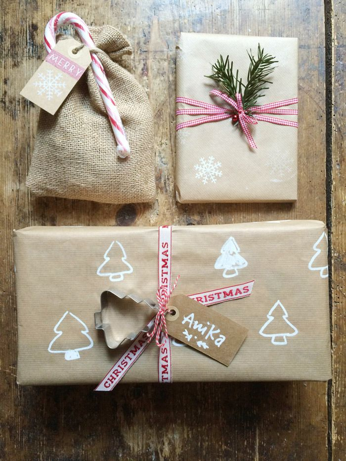 Kraft Paper Packages | hand-stamped and embellished with ribbon, candy canes, cookie cutters and greenery