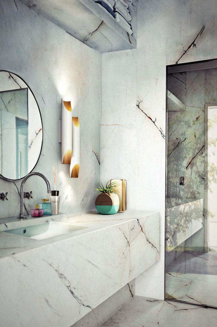 Bathroom vanities that are practical and so pretty. It's less about storage and more about luxury in this wet zone. Showcasing the 'Galliano' wall sconce from Delightfull, this bathrooms shows stone-cold look (delightfull.eu/en).