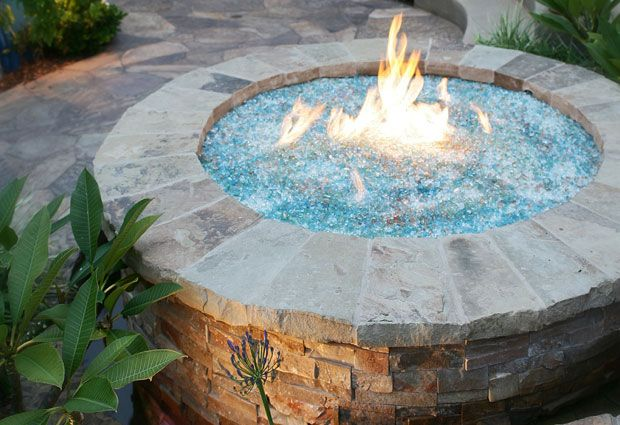 FIre & water fire pit, love this. Ok it is not actually water but fire glass. rcpblock sells the stuff to get the job done, plus an outdoor fireplace kit, stone veneer and other rocky/stone/brick outdoor stuff.