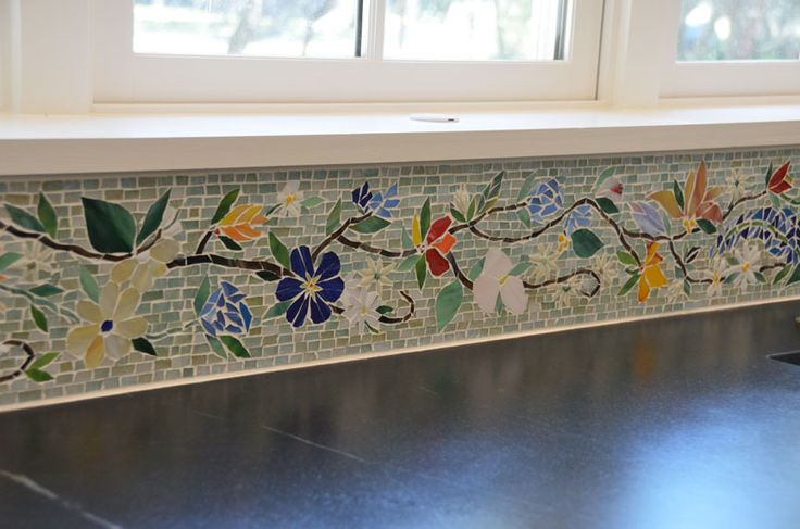 """We created this colorful floral mosaic border for our Florida client's kitchen. It is 6"""" high and 10 feet long. The floral mosaic is all hand-cut glass tiles set to a tile backerboard. The borde..."""
