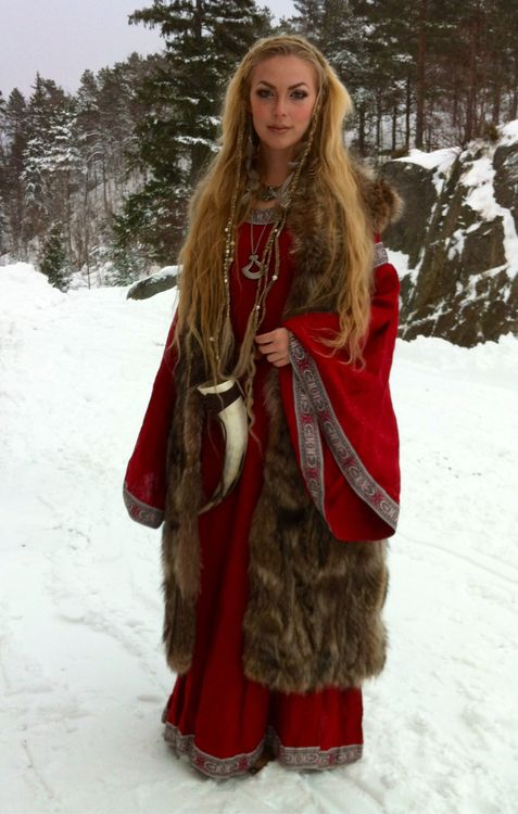 This woman is beautiful, love the dress and the fur!