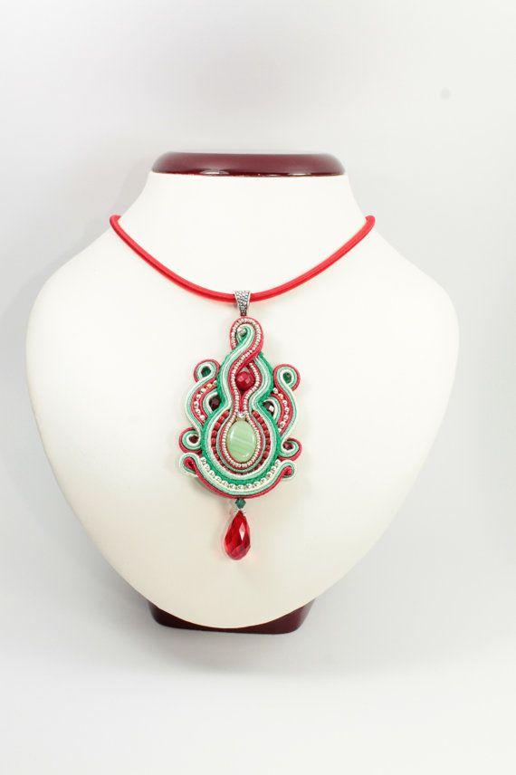 Red green soutache pendant.The pendant measures 9.5 cm Measures about 48.5cm.