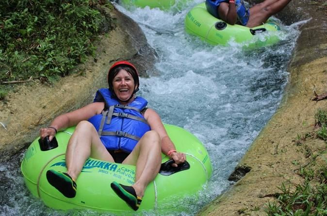 Ziplining, River Tubing and Blue Hole Adventure from Runaway Bay Treat yourself to a thrill of a lifetime on three miles of stunning White River and gain a new perspective on natural beauty. Soar through the air on a Zipline over the lush rainforest canopy. Fall for Jamaica as you fall back into your tube and get up close and personal with Jamaica's watery wonders.Then you'll betaken further down the river to the stunning Blue Hole. Climb along the many casca...