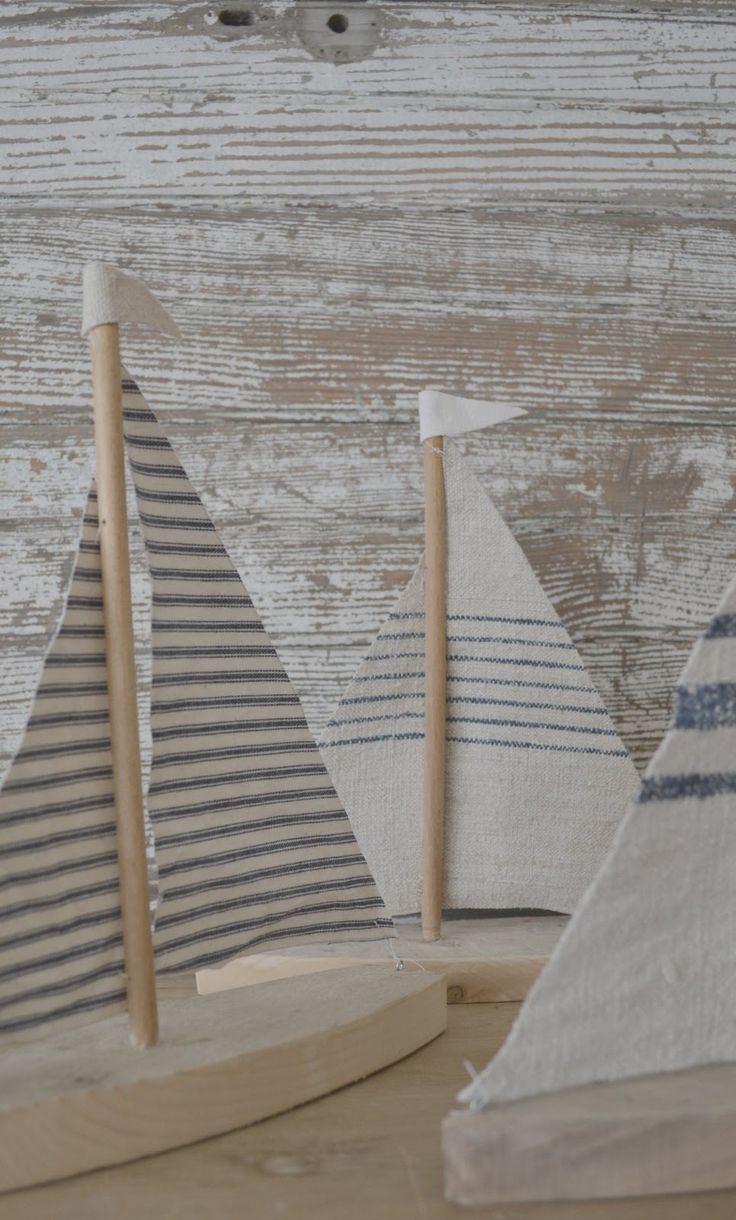 Little sailboats made out of 100 year old barn wood with scraps of  Vintage French Grain Sac fabric! DIY