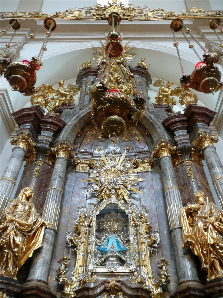 This is where the Infant of Prague resides. His robes are frequently changed and he gets dressed in many different, beautiful cloaks.