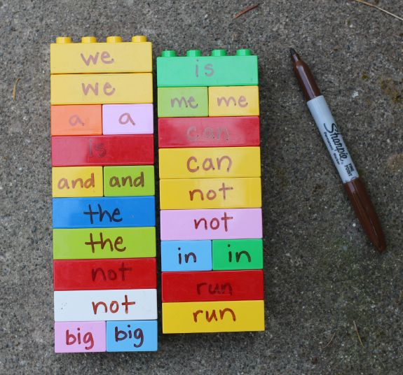 REUSE LEARNING DUPLOS: Write in permanent marker. When done, color OVER it with dry erase marker. Then wipe off with paper towel!  Ideas: word families, sentence building, math problems, etc.