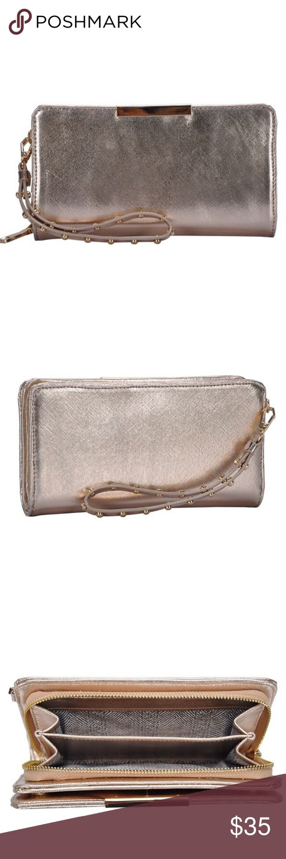 """Rose Gold Metallic Riveted Wallet DESCRIPTION  Look to MMS Trading to add a feminine touch to your look. The Rivvet Wallet comes with plenty of pockets to keep cash secure and a removable wrist strap for versatile carrying.  Item # 418718 UPC # 450002662216 FEATURES  Faux leather Top zip closure Removable 6½"""" wrist strap Interior Pockets: 3 paper accordian, 2 paper money slips, 1 zip & 8 card slots Fabric lining 8"""" L x 1"""" W x 4½"""" H MMS Design Studio Bags Wallets"""