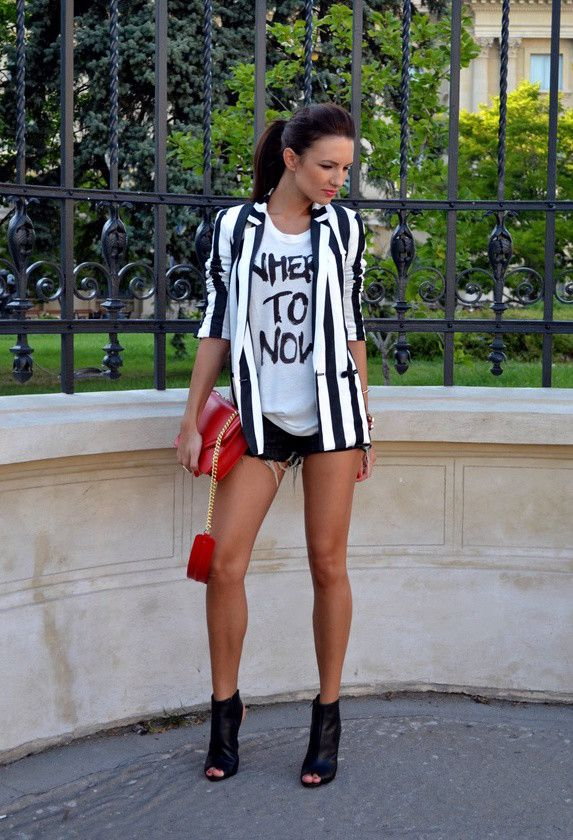 Striped blazer over white tee with graphic, black jean shorts and heels, popping red bag