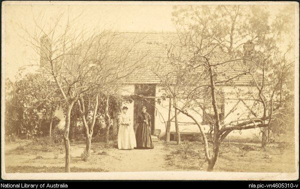 Merlin, Beaufoy, approximately 1830-1873. Two women standing outside whitewashed cottage with garden, Hill End, New South Wales, ca. 1873 [p...