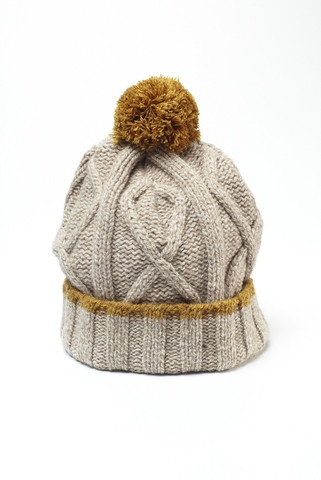 Bobble cable knit hat by Universal Works