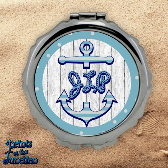 Monogrammed nautical compact mirror/blue stripe anchor bridesmaid compact purse mirror/custom nautical anchor pocket mirror cosmetics gift featuring bleached wood background and adorned with a light blue striped anchor and your initials in a nautical rope font.