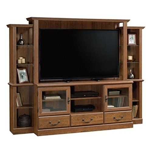 """Bowery Hill Entertainment Center in Milled Cherry. Features: Finish: Milled Cherry; TV should be mounted to back wall (wall mount conversion kit not included); Two adjustable shelves behind framed, safety-tempered glass doors; Center adjustable shelf holds audio/video equipment; Six adjustable display shelves; Three drawers with patented T-lock drawer system. Specifications: Overall Product Dimensions: 63.3"""" H x 82.2"""" W x 19.5"""" D; Product Weight: 257 lbs; Accommodates up to a 42"""" TV…"""
